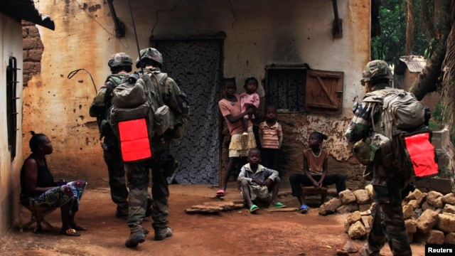 French soldiers conduct a daytime patrol in a Bangui neighborhood after shooting continued overnight in the capital, in Central African Republic, Dec. 26, 2013.