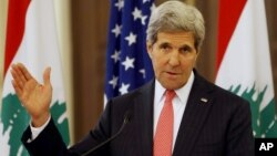 U.S. Secretary of State John Kerry speaks during a press conference after his meeting with Lebanese Prime Minister Tamam Salam, at the government palace, in Beirut, Lebanon, June 4, 2014.