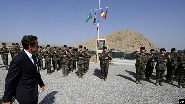 French President Nicolas Sarkozy visits French troops at the 152nd Infantry Regiment military base in Tora in the region of Surobi, Afghanistan, July 12, 2011