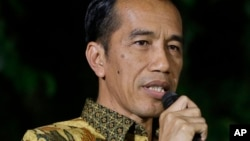 FILE - Indonesian President-elect Joko Widodo speaks during a press conference at his residence in Jakarta, Indonesia.
