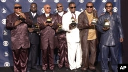 FILE - The Blind Boys Of Alabama hold Grammys for Best Traditional Soul Gospel Album at the 45th Annual Grammy Awards, Feb. 23, 2003, in New York.