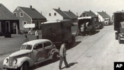 People move into new homes in Levittown, New York, in October 1947. Levittown served as a model for planned communities for the baby boom generation.