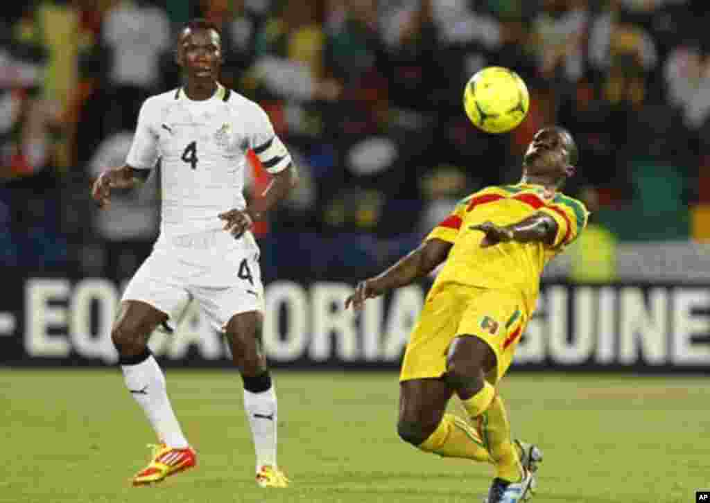 Mali's Berthe Osman (R) challenges Pantsil John (L)of Ghana during their African Cup of Nations Group D soccer match in FranceVille Stadium January 28, 2012.