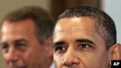 美国总统奥巴马(前)和国会众议院议长贝纳(后)