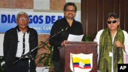 FILE - Ivan Marquez, chief FARC negotiator, with Central Staff member Jesus Santrich, right, and rebel commander Joaquin Gomez, left, speaks at a news conference at the close of a round of peace talks with Colombia's government in Havana, Feb 12, 2015.