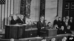 File - President Lyndon B. Johnson delivers State of the Union address to joint session of Congress, Washington, Jan. 8, 1964.