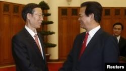 中国国务院副总理张高丽(左)与越南总理阮晋勇