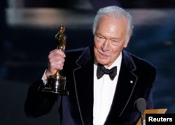 """FILE - Christopher Plummer, accepts the Oscar for best supporting actor for his role in """"Beginners"""" at the 84th Academy Awards in Hollywood, Calif., Feb. 26, 2012."""