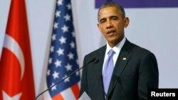 奧巴馬去年G20峰會上講話資料照。
