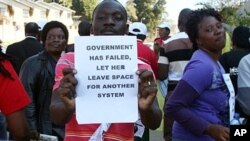 Activists demonstrate in the streets of Mbabane on July 21, 2011 to draw attention to their government's dwindling supply of anti-retroviral drugs, as Swaziland is the world's highest HIV infection rate.