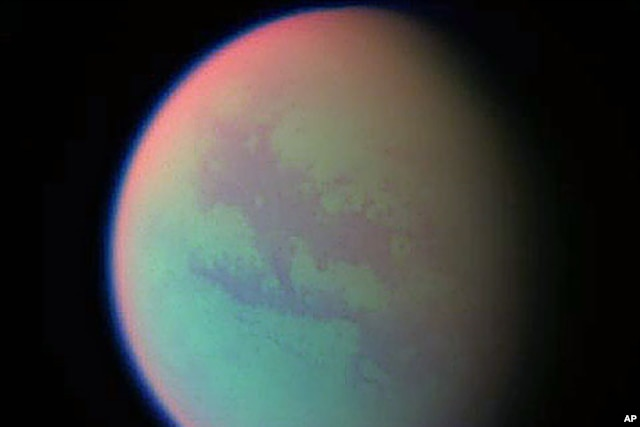 This false-color composite was created with images taken during the Cassini spacecraft's closest flyby of Titan, April 2005. (file photo)