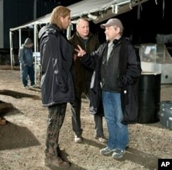 Left to right: Chris Hemsworth (as Thor), Stellan Skarsgård (as Selvig), and director Kenneth Branagh discuss a scene on the set of THOR, from Paramount Pictures and Marvel Entertainment.