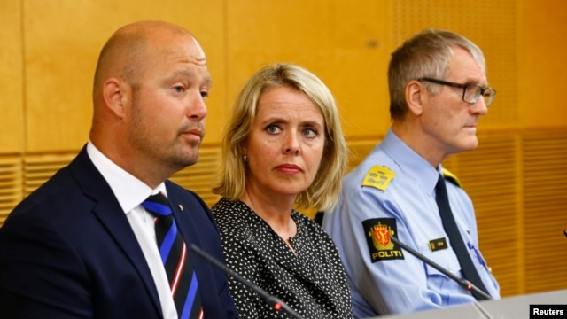 From left: Norwegian security officals Anders Anundsen, Benedicte Bjoernland and Vidar Refvik host news conference, Oslo, July 24, 2014.