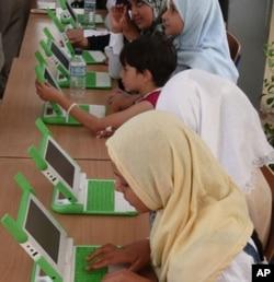 Gilrs in Najmi, Muthanna province, Iraq with OLPC computers.