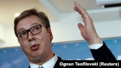 Serbia's President Aleksandar Vucic talks at a news conference during trilateral meeting in Ohrid