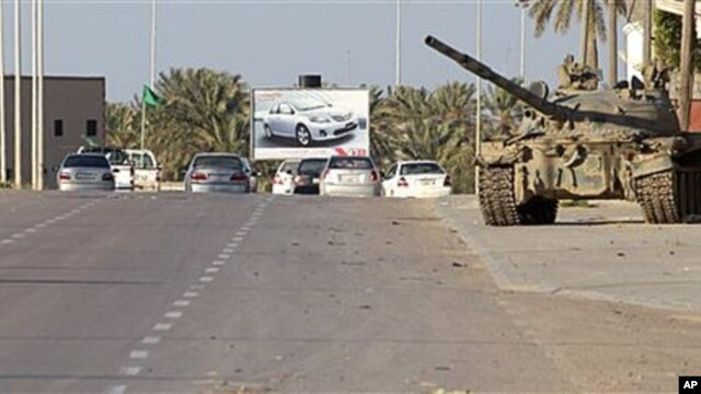 In this photo taken during a trip organized by Libyan authorities, a Libyan tank stands at in the outskirts of the coastal city of Misrata, 125 miles (200 kilometers) southeast of Tripoli, April 8, 2011