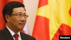 Phạm Bình Minh trong một sự kiện đón tiếp Ngoại Trưởng Canada tại Hà Nội.