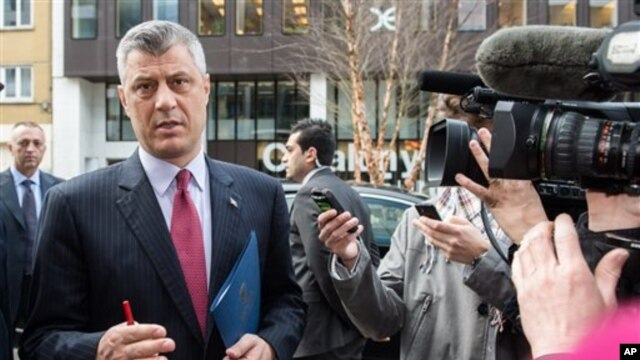 Kosovo's Prime Minister Hashim Thaci talks with journalists as he arrives for a meeting with EU foreign policy chief Catherine Ashton at the European Diplomatic Service headquarters in Brussels, April 17, 2013.