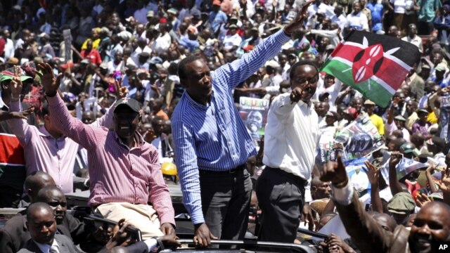 Kenya's former Education Minister William Ruto, center left, Kenya's Deputy Prime Minister Uhuru Kenyatta, center, and Kenya's Vice President Kalonzo Musyoka, center right, wave to thousands of people during a prayer rally at Uhuru Park, Kenya, Monday, Ap