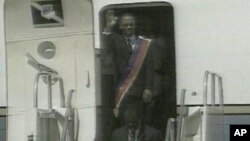 Jean-Bertrand Aristide returning to Haiti in 1994 after being ousted from power