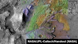 FILE: Formations made by water and sediment are seen in the Jezero Crater on Mars, the landing site for the Perseverance rover, in this false color image taken by NASA, published on May 15, 2019 and obtained November 15, 2019. (NASA/JPL-Caltech/Handout)