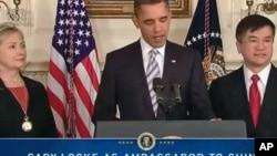 被美国总统奥巴马提名担当下任美国驻华大使的骆家辉(右)