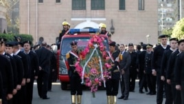 Firefighters attend the funeral service of General Mohamed Saeed, head of the technical office of the minister of interior, in Cairo, Egypt, Jan. 28, 2014.