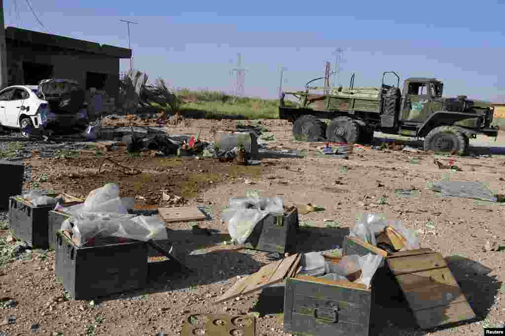 Ammunition and an abandoned military truck belonging to forces loyal to President Bashar Al-Assad is seen after clashes in Raqqa province, eastern Syria, June 16, 2013.