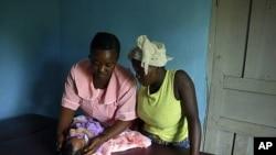 Margaret, MCHaid at Pendembu clinic examines a new born in Kallahun, Sierra Leone