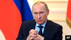 Tổng thống Nga Vladimir Putin trả lời họp báo tại dinh tổng thống Novo-Ogaryovo bên ngoài Moscow, ngày 4/3/2014.