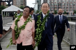 FILE - Palau President Tommy Remengesau (left) and United Nations Secretary General Ban Ki-moon (center) arrive for ceremonies for the observance of World Oceans Day, in New York, June 8, 2016.