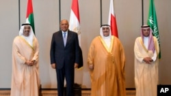 In this July 30, 2017, photo released by Bahrain News Agency, from left to right, Foreign Ministers Abdullah bin Zayed al-Nahyan of the UAE, Sameh Shoukry of Egypt, Khalid bin Ahmed al-Khalifa of Bahrain and Adel al-Jubeir of Saudi Arabia pose for a photo during their meeting in Manama, Bahrain. The four Arab states that cut ties with Qatar met Sunday to discuss the diplomatic crisis.