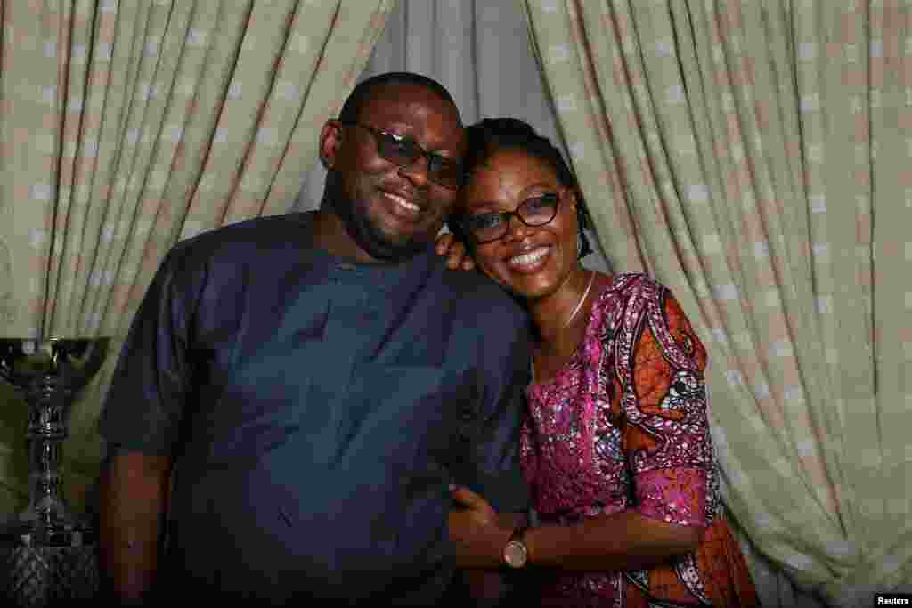 """Oladipupo Baruwa, 45, an investment promotion officer, and Funke Baruwa, 43, a gender and development expert, pose for a photograph at home in Abuja, Nigeria, Feb. 9, 2018. """"Well, he is persistent. We met at a church on the first Sunday service of the year 2000, and he followed me home after every service from that day on until about two years later. I just loved his persistence and the fact that he didn't want to give up,"""" Funke said. After the birth of their first daughter in 2013, the pair made a commitment that, whatever lay ahead, they would face it together. """"For me that has always been the unifying factor. ... Marriage is a commitment, it is a hard work and when you are willing to work at it, you get better,"""" Baruwa said."""