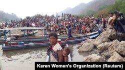 میانمار سے فرار ہو کر تھائی لینڈ پہنچنے والے پناہ گزین ۔ رائیٹرز مارچ 29,2021