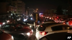 FILE - Vehicles are stuck in a traffic jam in Tehran, Dec. 21, 2017, after a magnitude 5.2 earthquake jolted a town near Iran's capital hours earlier.