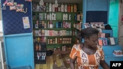 A shop sells skin-lightening products in Accra, Ghana, July 3, 2018. Africa is experiencing a massive trend of skin bleaching, also called lightening or whitening, particularly in teenagers and young adults. The widening phenomenon is laden with health ri