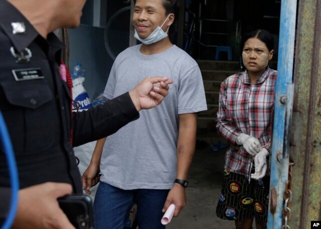 FILE - Burmese workers Tin Nyo Win, left, and Mi San smile upon being reunited in Samut Sakhon, Thailand, Nov. 9, 2015. They were separated while trying to escape the shrimp shed where they were held as slaves.