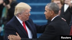 Donald Trump et Barack Obama lors de l'investiture du premier à Washington le 20 janvier 2017