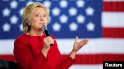 """U.S. Democratic presidential nominee Hillary Clinton answers a question from the audience at a """"Family Town Hall"""" campaign stop in Haverford, Pennsylvania, Oct. 4, 2016."""