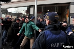 Members of the Garda Public Order Unit and riot police confront protesters at an anti-racism demonstration against the launch of an Irish branch of Pegida in Dublin, Ireland, Feb. 6, 2016.