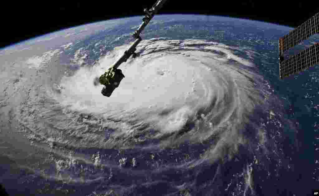 Photo provided by NASA shows Hurricane Florence from the International Space Station as it threatens the U.S. East Coast.
