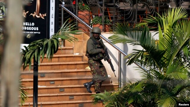 A Kenyan soldier walks out of the main gate of Westgate Shopping Center in Nairobi Sep. 22, 2013.