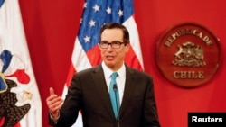 U.S. Treasury Secretary Steve Mnuchin speaks to the media next to Chile's Finance Minister Felipe Larrain (not pictured), during a meeting at La Moneda Presidential Palace in Santiago, Chile, March 21, 2018.