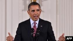 Presiden Barack Obama menyerukan pendekatan berimbang untuk mengurangi defisit dan mendorong pertumbuhan ekonomi. (AFP PHOTO/Jewel Samad)