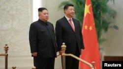 中国国家主席习近平在北京与朝鲜领导人金正恩见面。(2019年1月10日朝鲜朝中社发布)