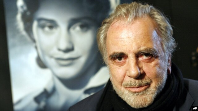 FILE - Maximilian Schell poses in front of a poster of his sister Maria Schell in Frankfurt, Germany, Jan. 30, 2007.