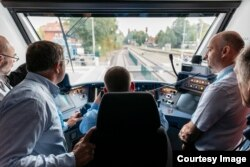 Officials ride the new Coradia iLint hydrogen-powered train that recently launched in northern Germany. (René Frampe/Alstom)