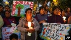 Vigilia en la víspera de la inauguración de la Conferencia sobre Cambio Climático en Lima, Perú.