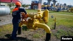 FILE - A worker turns a valve at an underground gas storage facility near Striy, Ukraine, May 21, 2014.