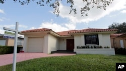 A report by S&P Case-Shiller claims a sharp rise in home prices over the past 12 months, increasing at the fastest pace since July 2014. Photo shows a house for sale in Coral Gables, Florida, Dec. 5, 2016.